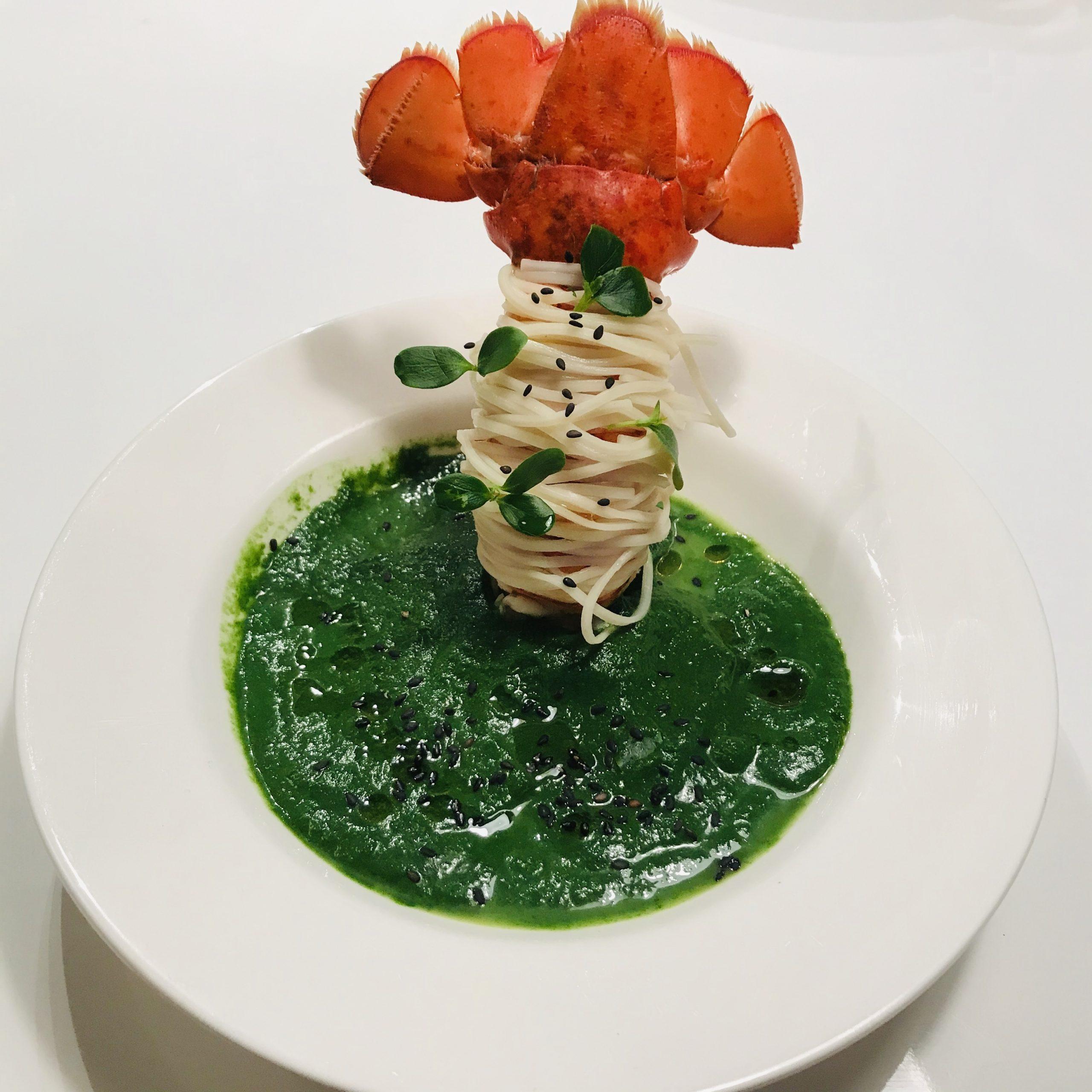 Kreeftenstaart in spinaziesaus